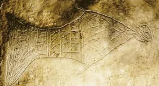 Imagem de um Peixe e um homem sengo engolido por ele, representando Jonas. Imagem gravada em pedra em uma tumba dos primeiros cristãos.